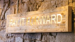 Image of wall display reading' pay it forward' for At Home, part of Maison Bleue Restaurants in Edinburgh