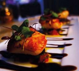 Image of beautifully prepared scallops for Maison Bleue Restaurant Edinburgh